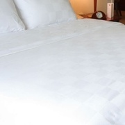 full size bed with white linens
