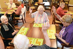 senior citizens playing bingo