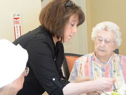 healthcare provider helping senior citizen