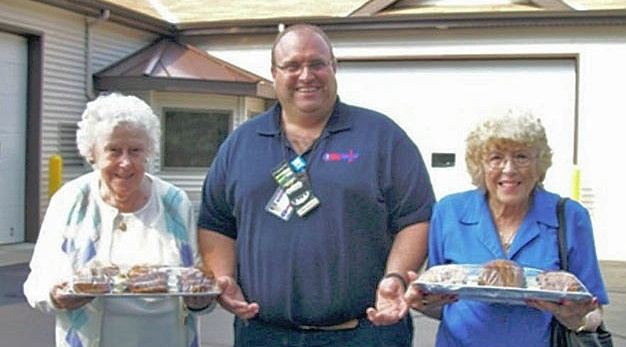 Senior citizens volunteering at bake sale