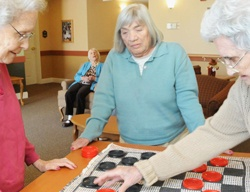 senior women playing checkers