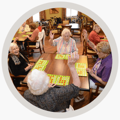 group of senior citizens playing board games together