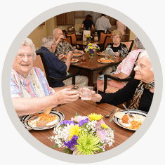 Senior citizens enjoying a meal together
