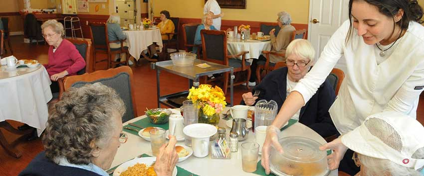 Table of senior citizens eating lunch