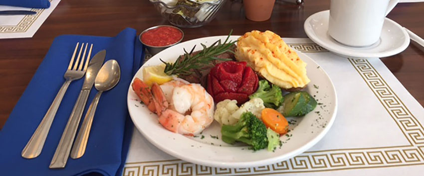 dinner plate with shrimp vegetables baked potato